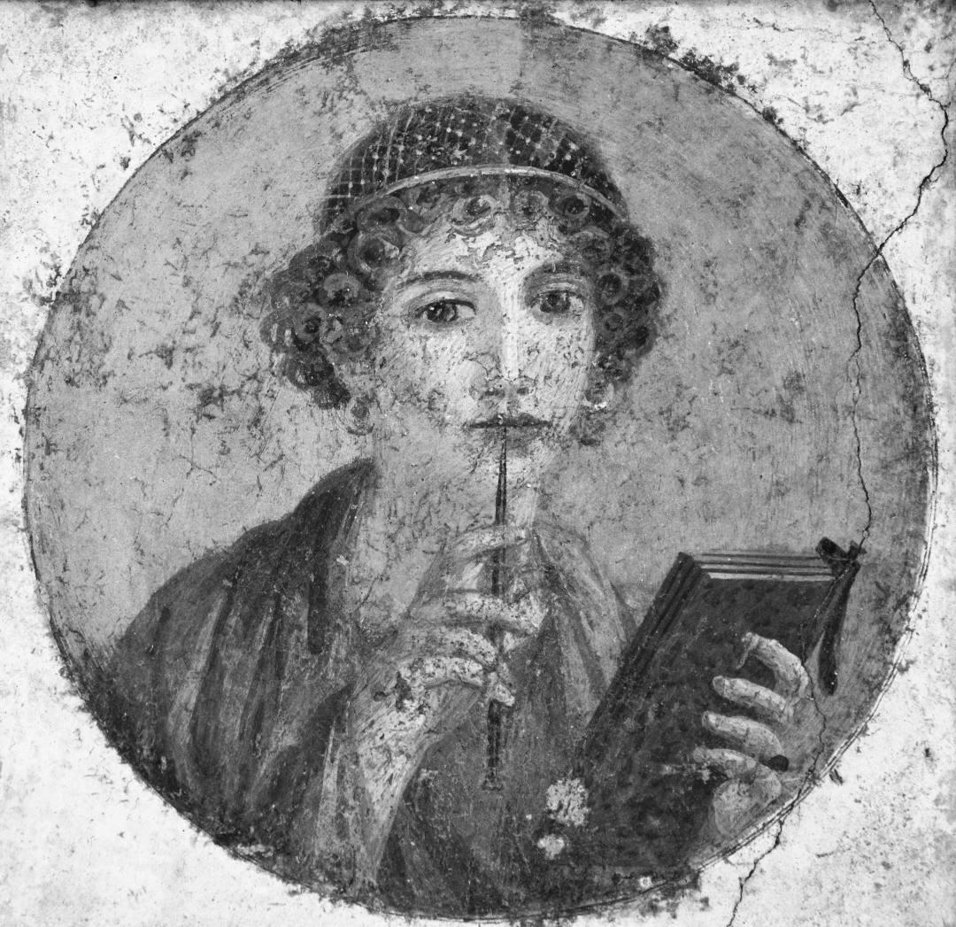 """Tondo con affresco romano, del 50 circa, di donna con libro e stilo (cosiddetta """"Saffo"""") proveniente da Pompei (Napoli, Museo archeologico nazionale) - Perché scrivere di sé"""